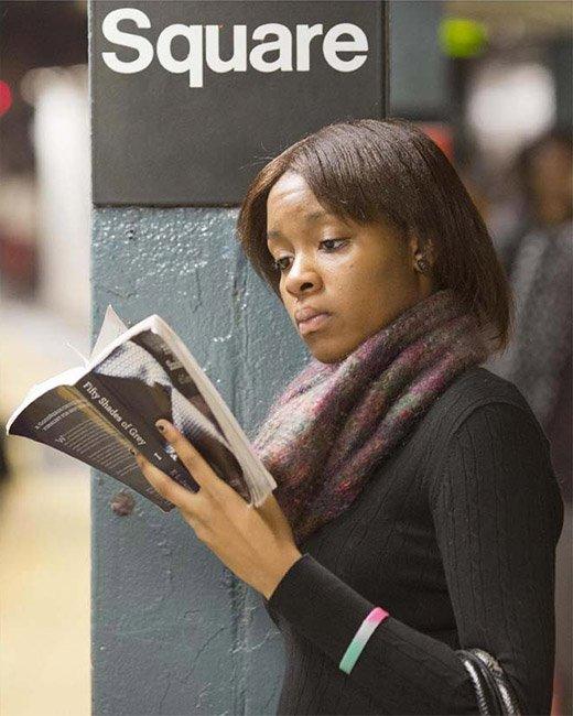Woman reading 50 Shades of Grey