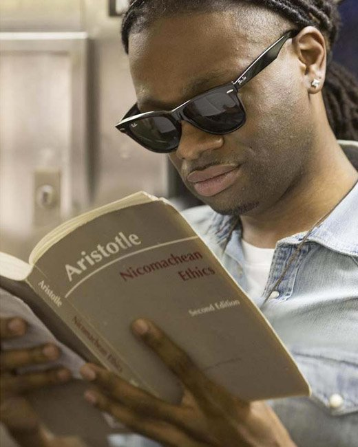 Man reading in the subway